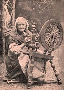 10042970~An-Old-Irishwoman-at-Her-Spinning-Wheel-Posters